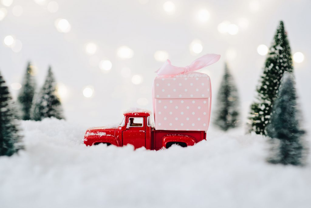 Toy pickup car carrying Christmas present