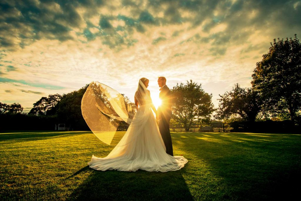 Wedding couple outdoor setting sun in essex